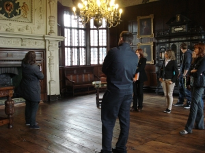 Giving a tour, in the Withdrawing room.